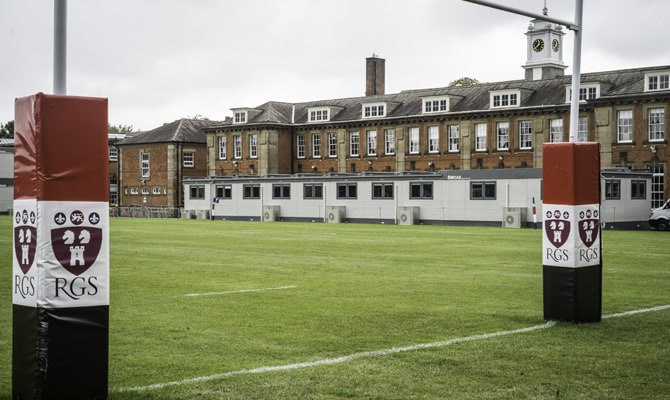 An image of SiBCAS modular PermaSpace classrooms at Newcastle Royal Grammar School, image taken from the rugby pitch showing the posts.