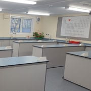 Science Lab desks inside SiBCAS Modular PermaSpace Classrooms Newcastle Royal Gramma School